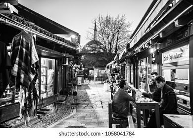 SARAJEVO, BOSNIA AND HERZEGOVINA - March 2018: Market street at old town Sarajevo, souvenir shops in Sarajevo, Bosnia and Herzegovina. Black and white photo.