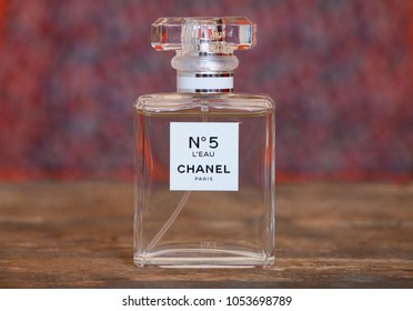 "SARAJEVO - BOSNIA AND HERZEGOVINA - MARCH 25, 2018: Perfume Chanel No. 5 with colorful background. Chanel No. 5 is the first perfume launched by French couturier Gabrielle ""Coco"" Chanel."