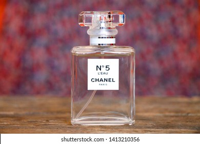 "SARAJEVO - BOSNIA AND HERZEGOVINA - MARCH 25, 2018: Perfume Chanel No. 5 with colorful background. Chanel No. 5 is the first perfume launched by French couturier Gabrielle ""Coco"" Chanel"