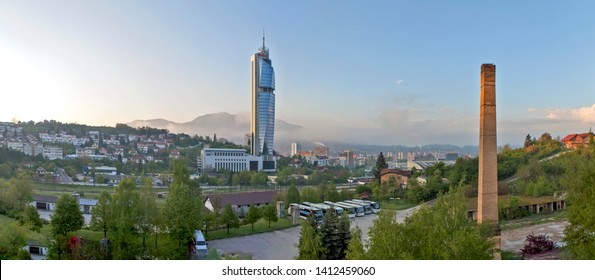 SARAJEVO, BOSNIA AND HERZEGOVINA - MAY 02, 2019: Photo of modern Avaz Twist tower (Avaz Twist Tower) is the highest in the Balkans and an old brick pipe. Panorama.