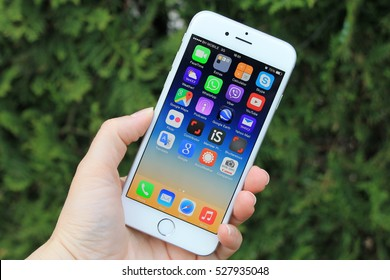 SARAJEVO , BOSNIA AND HERZEGOVINA - MAY 14 , 2015 : New iPhone 6 with colorful screen in woman's hand. iPhone 6 was created and developed by Apple inc.