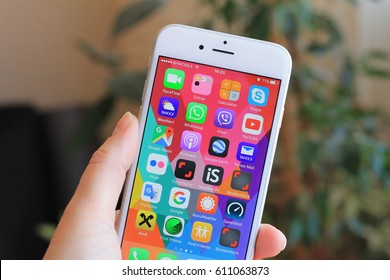 SARAJEVO , BOSNIA AND HERZEGOVINA -MAY 23 , 2016 : New gray iPhone 6 with colorful screen in woman's hand. iPhone 6 was created and developed by the Apple inc