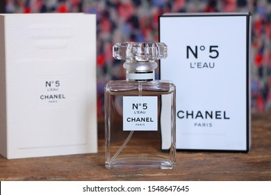"SARAJEVO - BOSNIA AND HERZEGOVINA - NOVEMBER 03, 2019: Perfume Chanel No. 5 with colorful background. Chanel No. 5 is the first perfume launched by French couturier Gabrielle ""Coco"" Chanel."