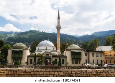 SARAJEVO / BOSNIA AND HERZEGOVINA - September 2, 2018: Outdoor view of Careva Dzamija mosque in Sarajevo on the miljacka riverbank.