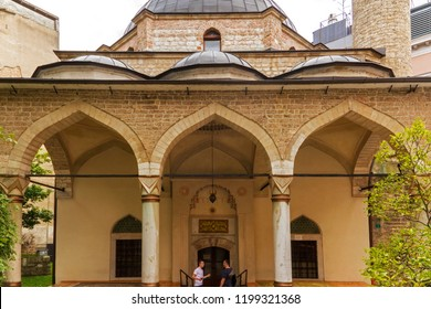 SARAJEVO / BOSNIA AND HERZEGOVINA - September 2, 2018:    Two people conversation at the main entrance of Ali Pasha mosque in Sarajevo.