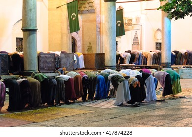SARAJEVO, BOSNIA AND HERZEGOVINA - SEPTEMBER 3, 2009: Segregated muslims bowing in Isha prayer at Gazi Husrev-beg mosque