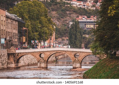 SARAJEVO, BOSNIA AND HERZEGOVINA - SEPTEMBER 4, 2018: Latin Bridge and Obala Kulina Bana street that runs along the right bank of the Miljacka river