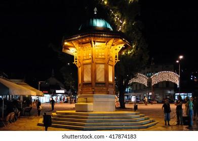 SARAJEVO, BOSNIA AND HERZEGOVINA - SEPTEMBER 4, 2009: The Sebilj wooden water fountain (Sebil), illuminated at night