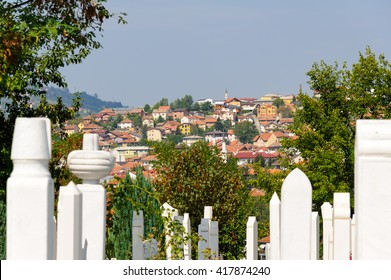SARAJEVO, BOSNIA AND HERZEGOVINA - SEPTEMBER 4, 2009: Alifakovac cemetery tombstones and view of the old Bistrik town