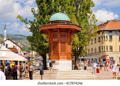 SARAJEVO, BOSNIA AND HERZEGOVINA - SEPTEMBER 4, 2009: The Sebilj wooden water fountain (Sebil) at Bascarsija square