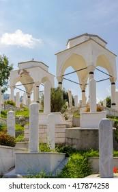 SARAJEVO, BOSNIA AND HERZEGOVINA - SEPTEMBER 4, 2009: Two white Ottoman turbe in the Alifakovac cemetery