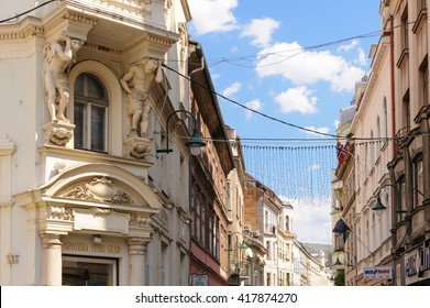 SARAJEVO, BOSNIA AND HERZEGOVINA - SEPTEMBER 4, 2009: Two atlantes supporting a balcony above the entrance to the pharmacy on the corner of Ferhadija street and Fra Grge Martica square.