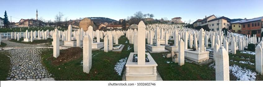 SARAJEVO, BOSNIA - JAN 25, 2018: Martyrs' memorial muslim cemetery Kovaci in Sarajevo. The graveyard is hosting a 90% of tombstones from 1992-1995. Aliya izzet begovic's graveyard is in this graveyard