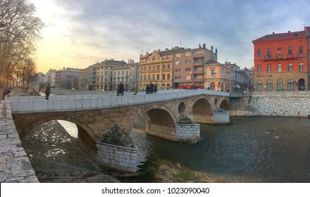 SARAJEVO, BOSNIA - JAN 25, 2018:Latin Bridge is an Ottoman bridge over the river Miljacka in Sarajevo Bosnia.The northern end of the bridge was the site of the assassination of Archduke Franz Ferdinan