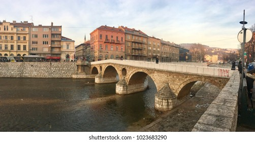 SARAJEVO, BOSNIA - JAN 25, 2018:Latin Bridge is an Ottoman bridge over the river Miljacka in Sarajevo.The northern end of the bridge was the site of the assassination of Archduke Franz Ferdinand.