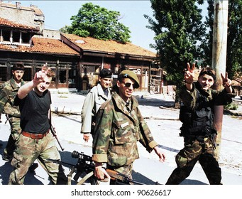 SARAJEVO, BOSNIA - JUNE 3: Bosnian army troops of the 10th Mountain Brigade run through the streets during fierce fighting in Sarajevo, Bosnia, on Thursday, June 3, 1993.