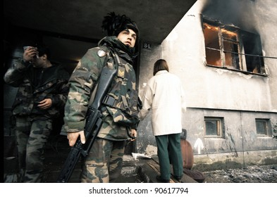 SARAJEVO, BOSNIA - MARCH 16: Italian army soldiers, in Bosnia as part of NATO's peacekeeping mission SFOR, attempt to restore order to the besieged Bosnian capital of Sarajevo Mar 16, 1996 in Sarajevo, Bosnia.