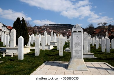 Sarajevo, Bosnia - March 23, 2015: Gravestones of Bosnian soldiers who died in Siege of Sarajevo (1992-96) during Yugoslav civil war at Martyrs' Memorial Cemetery Kovaci. A fortress is in background.