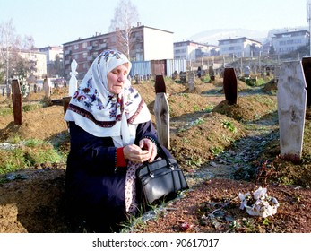SARAJEVO, BOSNIA - MAY 29: A Bosnian Muslim woman prays over the grave of her son in a Sarajevo graveyard. Her son was shot during fighting earlier in the week on May 29, 1993 in Sarajevo, Bosnia.