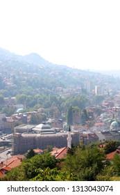 Sarajevo, Bosnia nad Herzegovina - September 25, 2011: Aerial view of Sarajevo from Yellow Fortress, with Sarajevo City Hall.