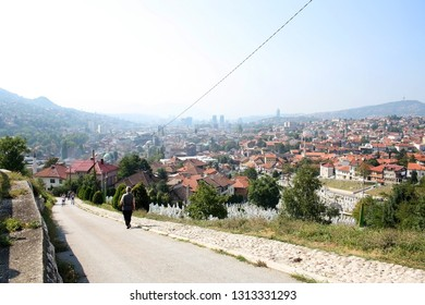 Sarajevo, Bosnia nad Herzegovina - September 25, 2011: Tourists visiting The Yellow Fortress, fort in Sarajevo, Bosnia and Herzegovina. Panoramic view of Sarajevo in the background.