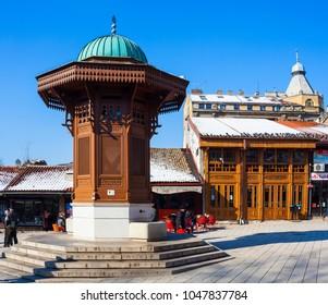 SARAJEVO, BOSNIA-ERZEGOVINA  - FEBRUARY, 16: The Sebilj is a pseudo-Ottoman-style wooden fountain (sebil) in the centre of Baš�aršija square on February 16, 2018