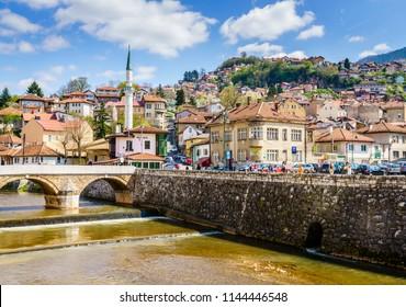 Sarajevo, Bosnia-Herzegovina, April 9, 2017: Miljacka River embankment in Sarajevo city center on a sunny spring day