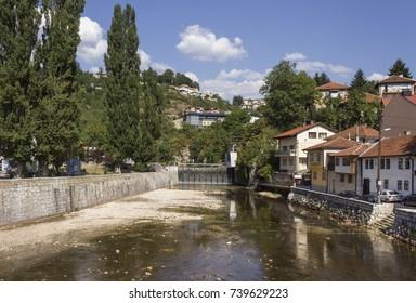 SARAJEVO, BOSNIA-HERZEGOVINA - AUGUST 18 2017: Miljacka river in Sarajevo in summer season