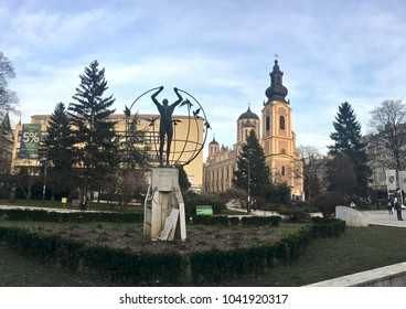 """SARAJEVO, BOSNIA-HERZEGOVINA - JAN 26, 2018: Statue """"Multicultural Man Builds the World""""  in Sarajevo. Located in what is known as """"Liberation Square,"""" it shows a man holding the meridians."""