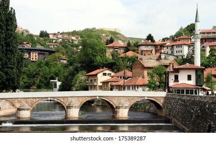 Sarajevo cityscape at Miljacka river with bridge, Bosnia and Herzegovina