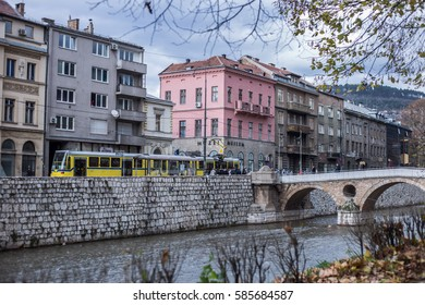 SARAJEVO - NOVEMBER 2016: River Miljacka and yellow tram in Sarajevo, Bosnia