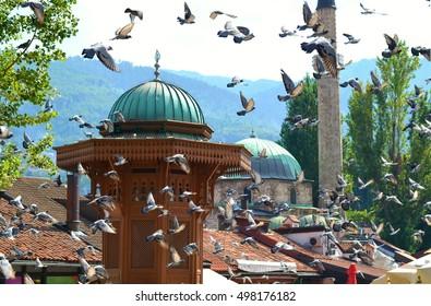 Sarajevo's old city center, Bascarsija, with famous Sebilj fountain and flying pigeons