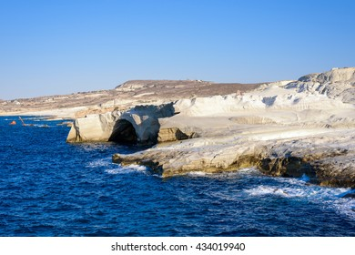 Sarakiniko, Melos, Greece. Complex shapes and gullies formed by water flowing into the gorge and out to sea between soft white rocks has carved out the stream bed into a moonscape.