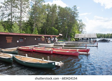 SARANAC LAKE, NEW YORK USA - JUNE  25, 2017: Boats tied to the the docks at Hickok's Boat Livery Saranac Lake New York, USA.