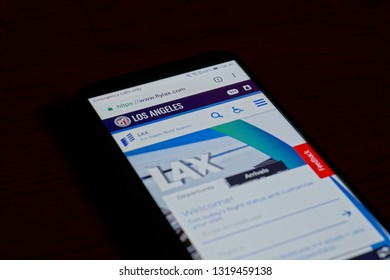 SARANSK, RUSSIA - FEBRUARY 10, 2019: A smartphone screen shows details of Los Angeles International Airport (LAX) home page on it's web site.