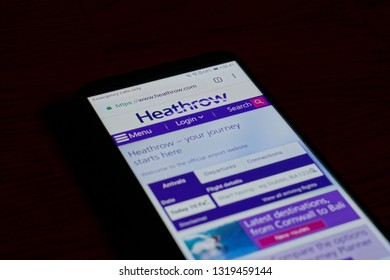 SARANSK, RUSSIA - FEBRUARY 10, 2019: A smartphone screen shows details of Heathrow Airport home page on it's web site.