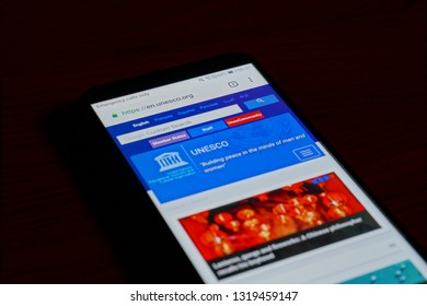 SARANSK, RUSSIA - FEBRUARY 10, 2019: A smartphone screen shows details of United Nations Educational, Scientific and Cultural Organization (UNESCO) home page on it's web site.