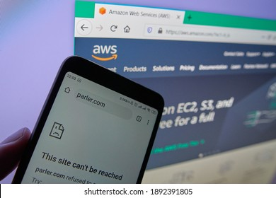 """SARANSK, RUSSIA - JANUARY 12, 2021: A smartphone screen shows error - """"This Site Can't Be Reached Error"""" of Parler web site. A web site of Amazon Web Services (AWS) visible on the background."""