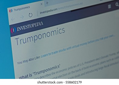 SARANSK, RUSSIA - JANUARY 17, 2017: A computer screen shows details of Investopedia Trumponomics Definition page on its web site. Selective focus.