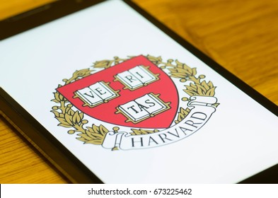 SARANSK, RUSSIA - JULY 02, 2017: A Smartphone screen shows logo of Harvard University. Selective focus.