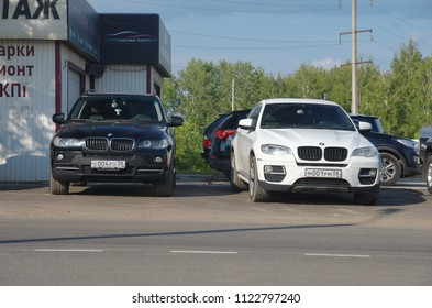 SARANSK, RUSSIA - JUNE 19, 2018: Black BMW X5 and white X6 parked on sideways.
