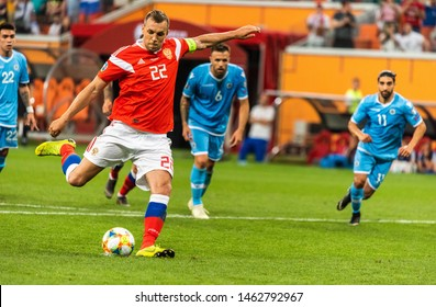 Saransk, Russia - June 8, 2019. Russia national team striker Artem Dzyuba performing a penalty kick during UEFA Euro 2020 qualification match Russia vs San Marino (9-0) in Saransk.
