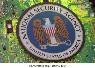 SARANSK, RUSSIA - MARCH 21, 2018: The National Security Agency seal printed on a paper and placed at circuit board.