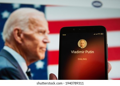 SARANSK, RUSSIA - MARCH 22, 2021: The smartphone with Vladimir Putin contact seen on it's screen and Joe Biden seen on the background.