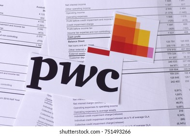 SARANSK, RUSSIA - NOVEMBER 05, 2017: The PricewaterhouseCoopers logo with financial reports.