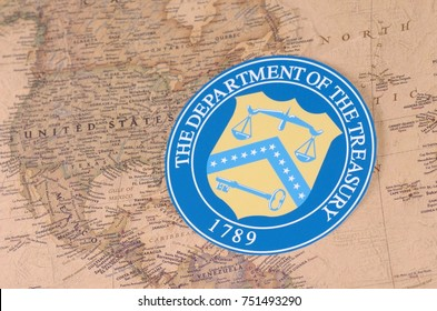 SARANSK, RUSSIA - NOVEMBER 05, 2017: The Seal of the U.S. Department of the Treasury with world map.