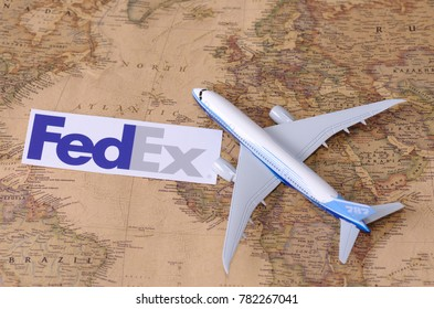 SARANSK, RUSSIA - NOVEMBER 05, 2017: FedEx logo with model of airplane on world map.