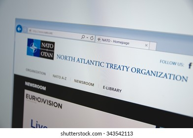 Saransk, Russia - November 24, 2015: A computer screen shows details of NATO (North Atlantic Treaty Organization) main page on its web site. Selective focus.
