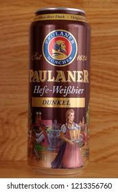 SARANSK, RUSSIA - OCTOBER 26, 2018: Can of Paulaner Hefe-Weibbier Dunkel on wooden background.