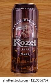 SARANSK, RUSSIA - OCTOBER 26, 2018: Can of Velkopopovicky Kozel dark on wooden background.